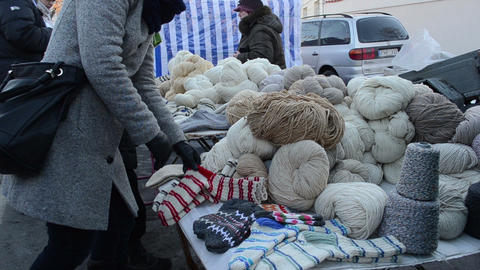 woman pick natural wool thread outdoor spring fair market... Stock Video Footage