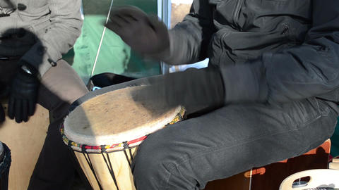 musician young play wooden handmade drum outdoor spring concert Footage