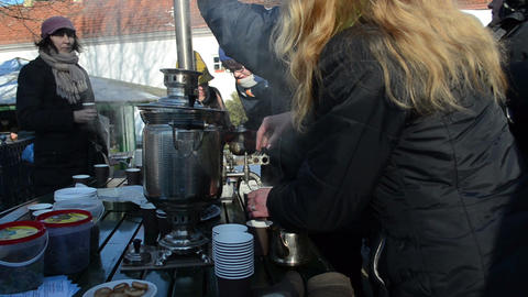 people drink hot tea coffee retro equipment tool spring event Footage