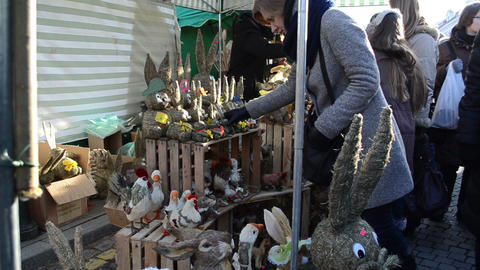 merchant sell handmade animal decorations people spring market Footage