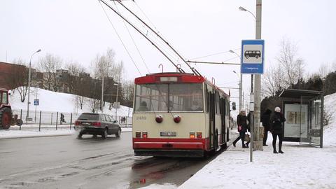 public transport trolley stop people snow winter Footage