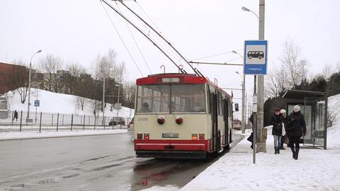 public transport trolley stop people snow winter Stock Video Footage