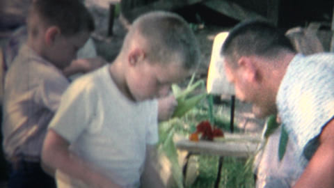 (8mm Vintage) 1962 Family Shucking Picnic Corn On The Cob Stock Video Footage