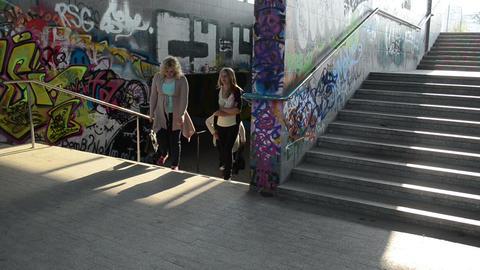 women walk upstairs from city underground dark passage subway Footage