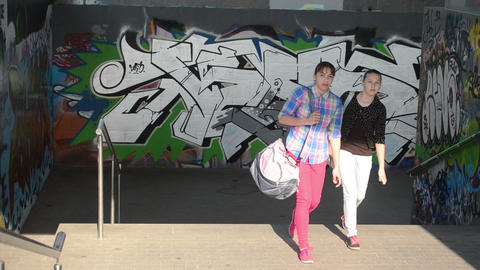 teenagers girls walks stairs city underground passage subway Footage