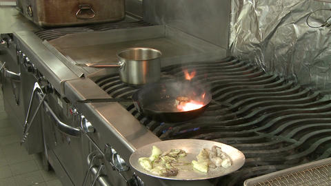 Skilled Chef frying food (3 of 5) Stock Video Footage