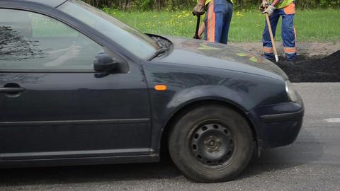workers shovel hot asphalt road holes heavy vibration roller Stock Video Footage