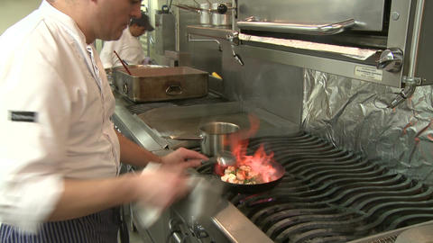 Skilled Chef frying food (1 of 5) Stock Video Footage