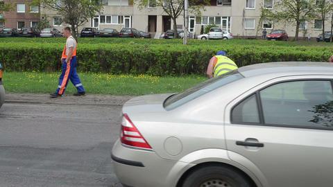 workers shovel hot asphalt street holes heavy vibration... Stock Video Footage