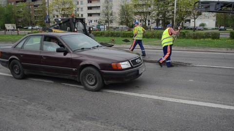 Workers uniform shovels load asphalt remain to small rv bobcat Footage