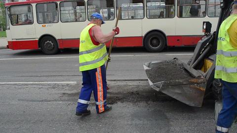 Worker uniform clean asphalt shovel brush truck people... Stock Video Footage