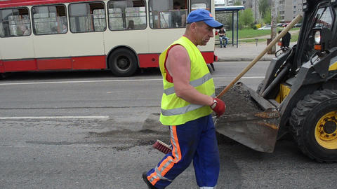 Worker uniform clean asphalt shovel brush truck people bus stop Footage