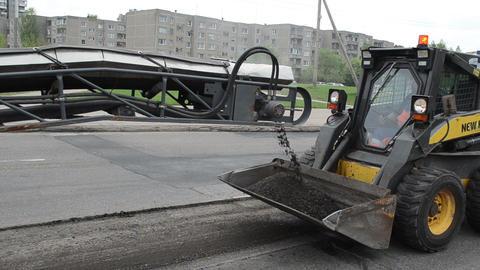 street asphalt remain loading to small rv bobcat truck... Stock Video Footage
