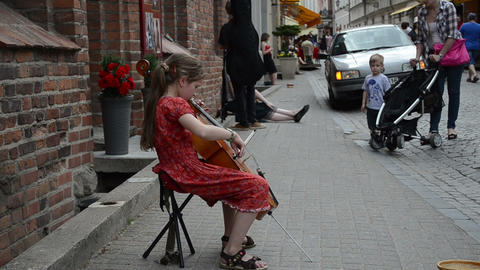 Young tired girl play with cello violoncello in street... Stock Video Footage