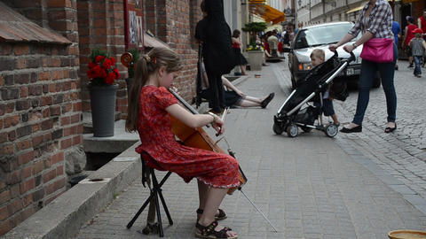 Young tired girl play with cello violoncello in street music day Footage