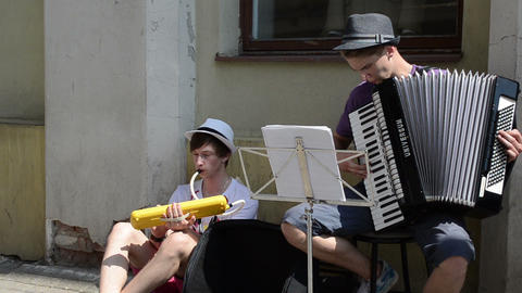 teenager musicians play music in street Footage