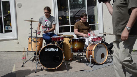 musicians play rhythm coca cola bottles and drums in street Footage