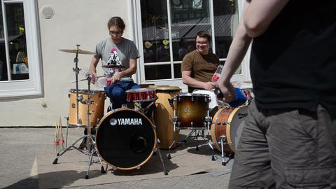 musicians play rhythm coca cola bottles and drums in street Stock Video Footage
