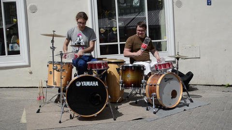 men play rhythm coca cola bottles and drums in street Stock Video Footage