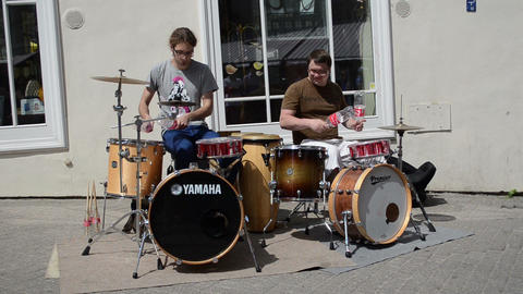 men play rhythm coca cola bottles and drums in street Footage