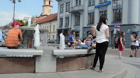 People with children have fun near city fountain hot... Stock Video Footage