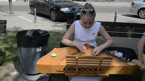 young girl hands synchronize Baltic psaltery string instrument Footage