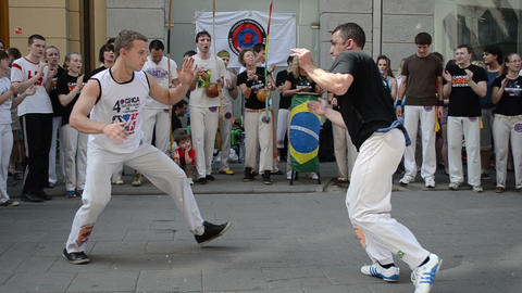 capoeira. two man fight surrounded by singing people circle Stock Video Footage