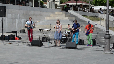 students rock band play electric guitars vocalist woman sing Stock Video Footage