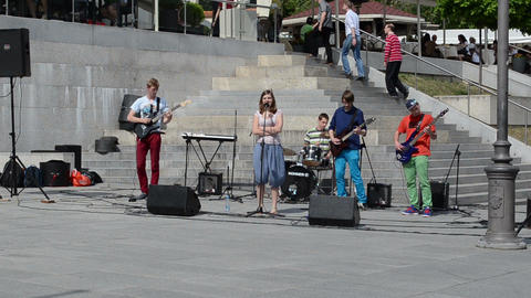 students rock band play vocalist woman sing people public Stock Video Footage