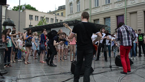 musician performance after rain and wet teenager enjoying... Stock Video Footage