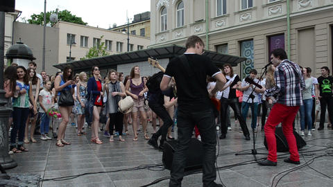 musician performance after rain and wet teenager enjoying music Footage