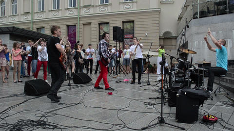 musician performance after rain and wet people fan enjoy... Stock Video Footage