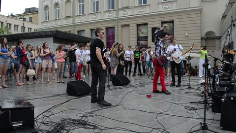 musician performance after rain and wet people fan enjoy music Footage