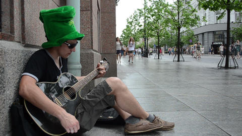 simple man singer with green hat play guitar and sing on... Stock Video Footage