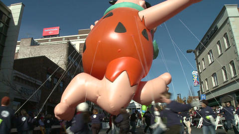 Fred Flintstone balloon at parade Stock Video Footage