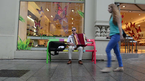 Old grey man play music with accordion. outdoor street... Stock Video Footage