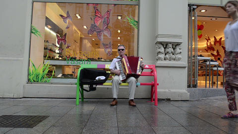 Old grey man play music with accordion. outdoor street festival Footage