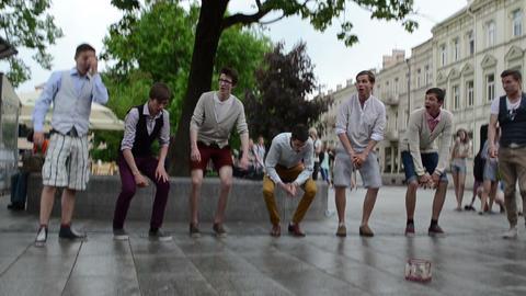 chorus boys teenagers sing glee song in public street festival Footage