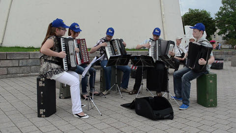 Group of young musicians play perform accordion music in... Stock Video Footage