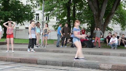 Young teenager girl perform street modern dance street festival Footage