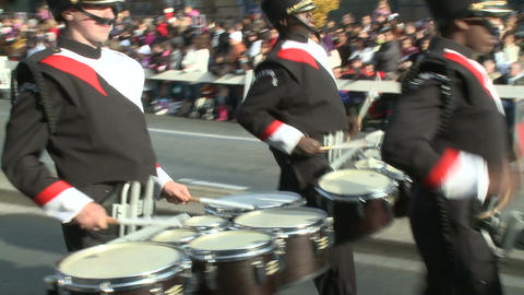 Marching band performs in city streets Stock Video Footage