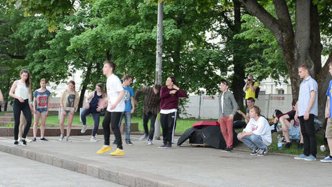 Group of young teenagers perform modern street dances Footage