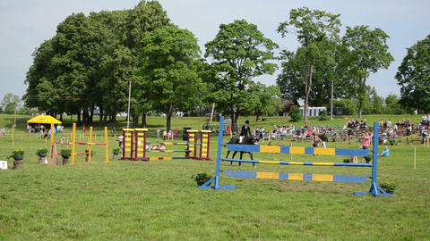 woman rider with horse jump barriers in steeplechase... Stock Video Footage