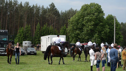 Ranger police riders prepare for show and woman walk with... Stock Video Footage