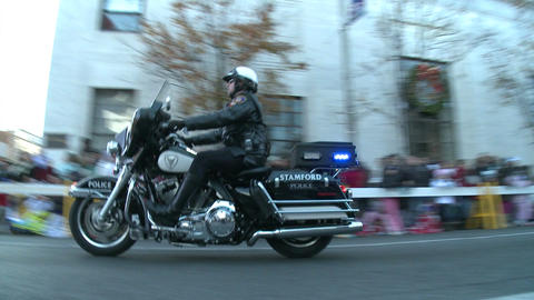 Tail end of police motorcade at parade Footage