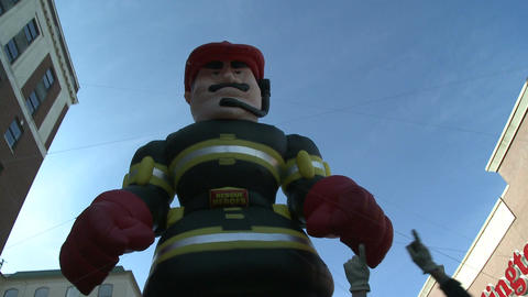 Giant Balloon of NYC Fireman at parade Stock Video Footage