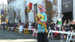 Clown on stilts during parade Stock Video Footage