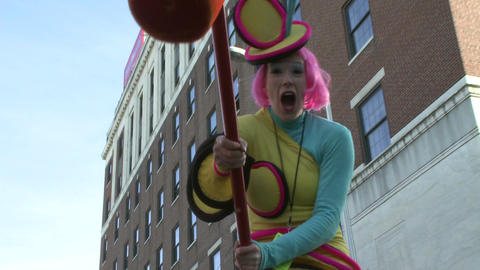Clown on stilts during parade Footage