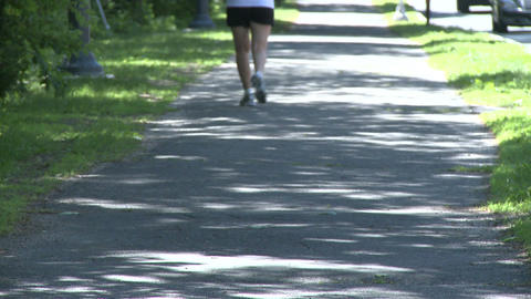 Jogger on path Stock Video Footage