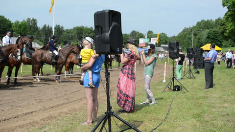 People enjoy ranger police riders in public horse festival Stock Video Footage
